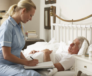caregiver assessing patient